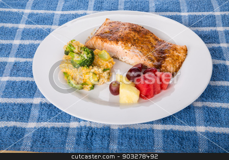 Baked Salmon with Broccoli Rice and Fresh Fruit stock photo, A plate of fresh, baked salmon with a broccoli, cheese and rice casserole and fresh cut fruit by Darryl Brooks