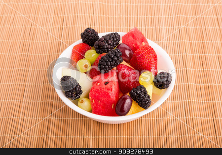 Berries Melons and Grapes in White Bowl stock photo, A bowl of fresh cut fruit by Darryl Brooks