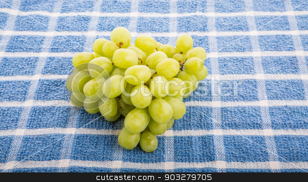 Green Grapes on Blue Towel stock photo, A bunch of green, seedless grapes on a blue towel by Darryl Brooks