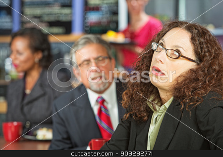 Angry Business Woman stock photo, Annoyed business woman next to man in coffee house by Scott Griessel