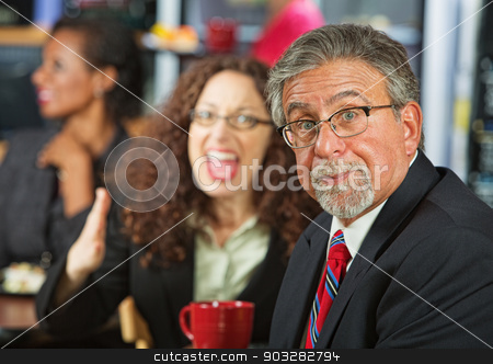 Arguing Coworkers stock photo, Frustrated businessman arguing with woman in cafeteria by Scott Griessel