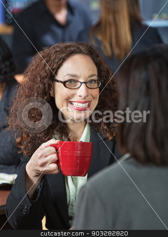 Cheerful Woman with Cup stock photo, Cheerful business woman with cup and friend by Scott Griessel