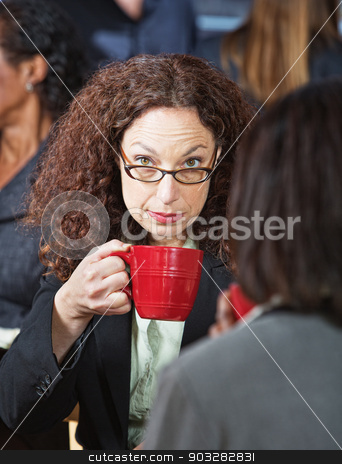 Serious Businesswoman with Cup stock photo, Serious business woman in eyeglasses with red cup by Scott Griessel