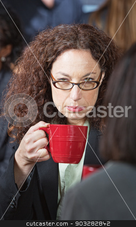 Offended Business Woman stock photo, Offended businesswoman with friend holding coffee cup by Scott Griessel