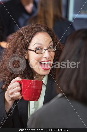 Surprised Woman in Cafe stock photo, Surprised woman laughing with friend in coffee house by Scott Griessel