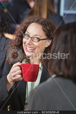 Happy Business Woman  stock photo, Laughing business woman with eyeglasses drinking coffee by Scott Griessel