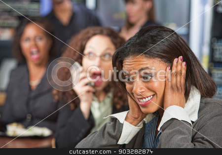 Woman Covering Ears stock photo, Pretty business woman covering ears while person talks on phone by Scott Griessel