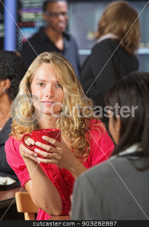 Cute Woman with Red Mug stock photo, Pretty young woman holding red mug in coffee by Scott Griessel