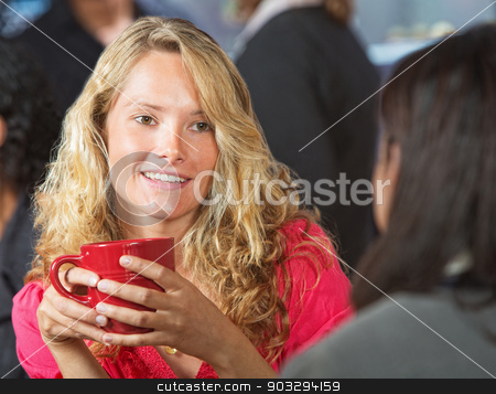 Young Woman in Cafe stock photo, Beautiful young woman talking with friend in cafe by Scott Griessel