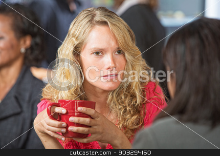 Concerned Woman in Cafe stock photo, Concerned young woman talking with friend in cafe by Scott Griessel