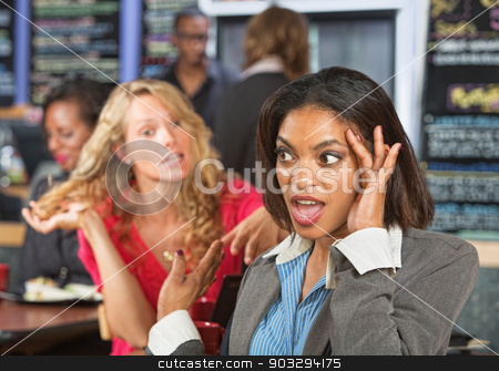 Irritated Woman in Cafe stock photo, Irritated business woman listening to emotional lady by Scott Griessel