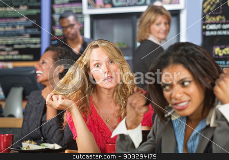 Crazy Woman in Cafe stock photo, Annoyed business woman next to loud blond woman by Scott Griessel