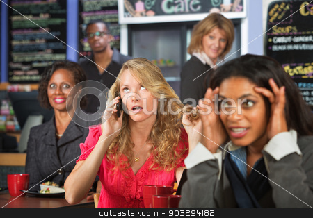 Obnoxious Woman on Phone stock photo, Loud blond woman on cell phone in restaurant by Scott Griessel