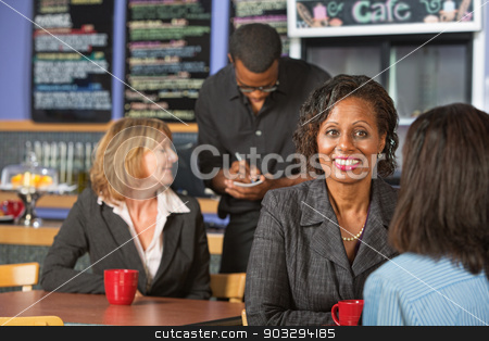 Mature Business Woman stock photo, Mature smiling business woman with friend in cafe by Scott Griessel