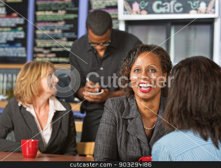 Cute Lady Laughing stock photo, Cute laughing mature business woman with friend in cafe by Scott Griessel