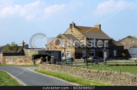 Farmhouse in the countryside stock photo, Scenic view of a farmhouse in the English countryside near to Whitby town. by Martin Crowdy