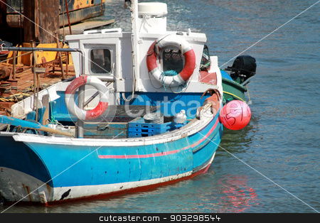 Fishing boat moored in a harbor stock photo, An old fishing boat moored in Scarborough harbor, North Yorkshire, England. by Martin Crowdy