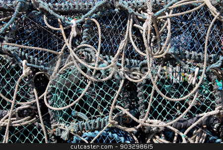 Fishing nets stock photo, Abstract background of tangled fishing nets. by Martin Crowdy
