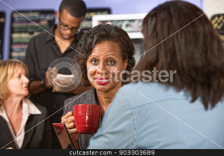 Cheerful Woman with Mug stock photo, Smiling African woman with coffee cup in restaurant by Scott Griessel
