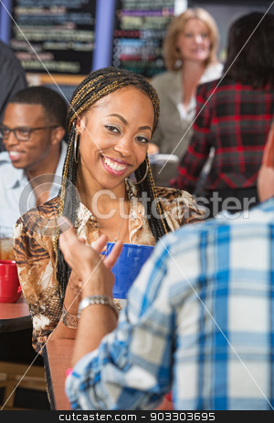 Pretty Woman in Cafe stock photo, Pretty woman with braids talking with man in cafe by Scott Griessel