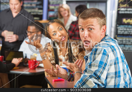 Embarrassed Man in Cafe stock photo, Embarrassed Caucasian man with young woman in cafe by Scott Griessel