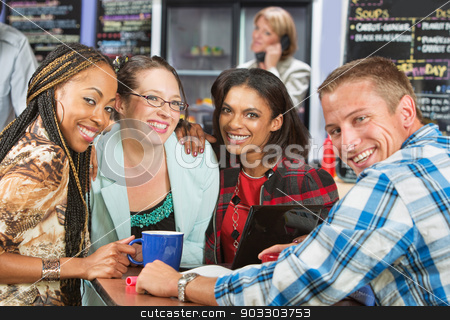 Four Diverse Friends stock photo, Diverse group of friends smiling in coffee house by Scott Griessel