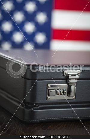 Leather Briefcase Resting on Table with American Flag Behind stock photo, Black Leather Briefcase Resting on Table with American Flag Behind. by Andy Dean