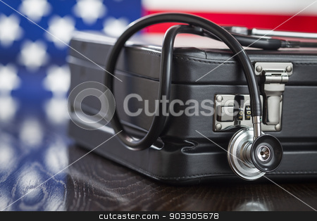 Briefcase and Stethoscope Resting on Table with American Flag Be stock photo, Leather Briefcase and Stethoscope Resting on Table with American Flag Behind. by Andy Dean