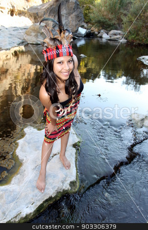 Indian Woman stock photo, Native american woman next to a creek. by Henrik Lehnerer
