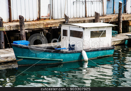 Old Blue and White Fishing Boat stock photo, An old wood fishing boat in a harbor by Darryl Brooks