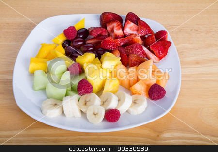 Cut Fruit with Mangos Bananas and Strawberries stock photo, Fresh cut fruit on a white plate with strawberries, mango, pineapple, grapes, bananas, and melon by Darryl Brooks