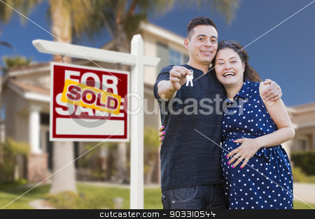 Hispanic Couple, Keys, New Home and Sold Real Estate Sign stock photo, Young Happy Pregnant Hispanic Young Couple with House Keys in Front of Their New Home and Sold For Sale Real Estate Sign. by Andy Dean