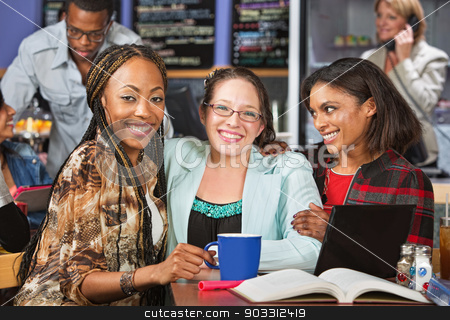 Young Friends Studying stock photo, Diverse group of young women studying in cafe by Scott Griessel