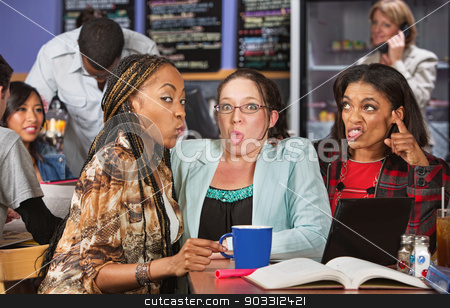 Grossed Out Students stock photo, Young woman with disgusted friends studying in bistro by Scott Griessel