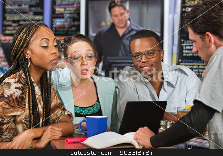 Four Students Studying stock photo, Diverse group of four male and female students in cafe by Scott Griessel