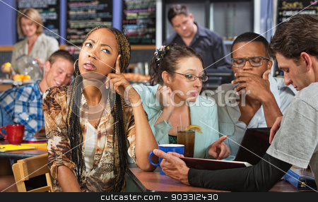 Young Student Thinking stock photo, Smart young student with friends in cafe by Scott Griessel