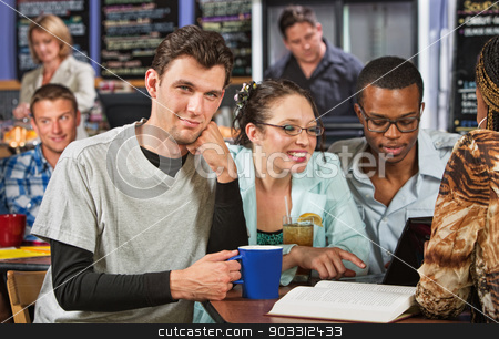 Confident Student stock photo, Confident Caucasian male student with friends in cafe by Scott Griessel