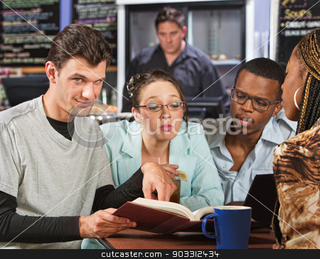 Clever Student with Friends stock photo, Clever male with students in coffee house by Scott Griessel