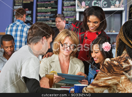 Mixed Group of Students stock photo, Mature woman studying with friends in coffee house by Scott Griessel