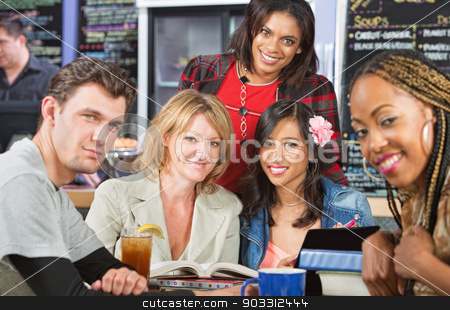 Grinning Students stock photo, Diverse group of grinning students in cafe by Scott Griessel