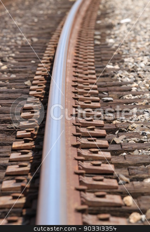 Train Track stock photo, One single train track in gravel with a curve. by Henrik Lehnerer