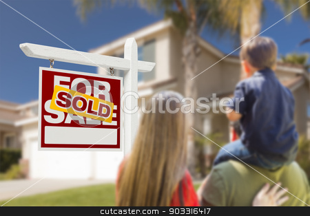 Family Facing Sold For Sale Real Estate Sign and House stock photo, Curious Family Facing Sold For Sale Real Estate Sign and Beautiful New House. by Andy Dean