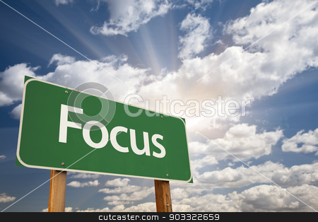 Focus Green Road Sign stock photo, Focus Green Road Sign with Dramatic Clouds and Sky. by Andy Dean