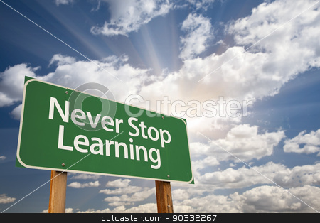 Never Stop Learning Green Road Sign stock photo, Never Stop Learning Green Road Sign with Dramatic Clouds and Sky. by Andy Dean