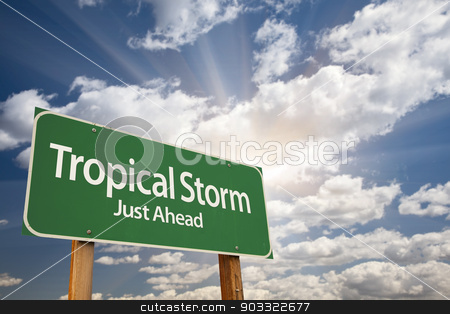 Tropical Storm Green Road Sign stock photo, Tropical Storm Green Road Sign with Dramatic Clouds and Sky. by Andy Dean
