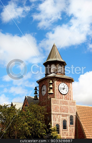 Solvang Bell Tower stock photo, A bell tower in the city of Solvang with a cloudy sky in the background. by Henrik Lehnerer