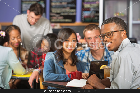 Handsome Man with Friends stock photo, Handsome young African man with friends in cafe by Scott Griessel