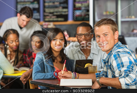 Happy Student with Friends stock photo, Handsome Caucasian student doing homework with friends by Scott Griessel