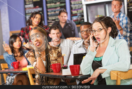 Talkative Woman in Cafe stock photo, Talkative female on cell phone annoying students in cafe by Scott Griessel