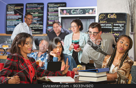 Annoying Nerd with Group stock photo, Mixed group of students annoyed with nerd in cafe by Scott Griessel